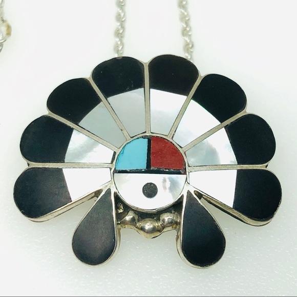 Chain pendant with Netsuke-style inlays